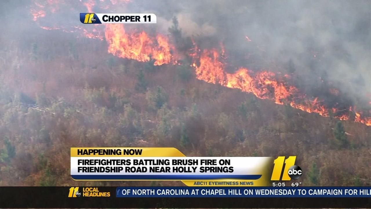 Crews battle brush fire near Holly Springs