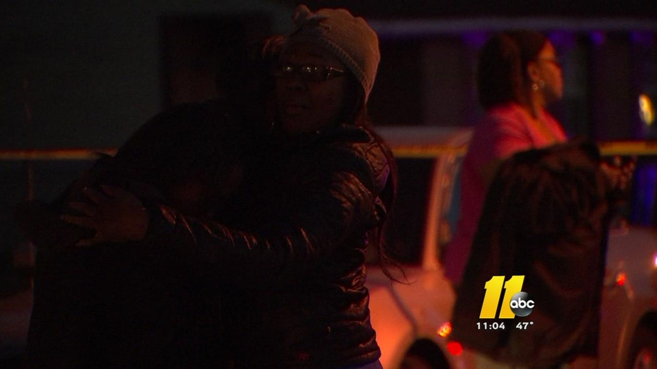A Durham neighborhood mourns after a shooting claims a young life