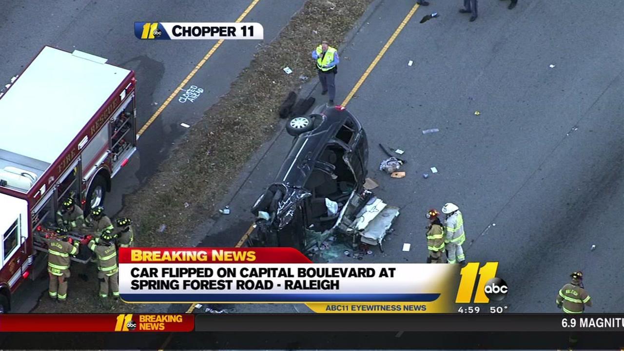 Car flips on Capital Boulevard