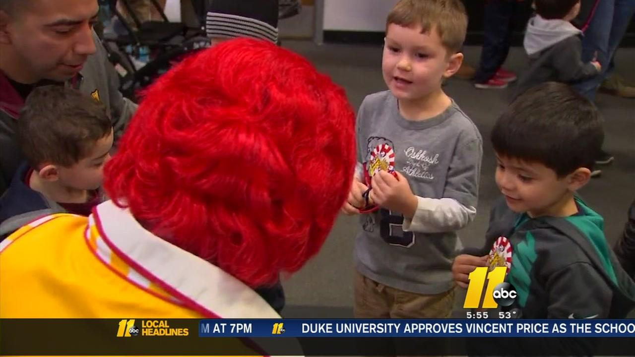 Ronald McDonald joins up with the military toy giveaway