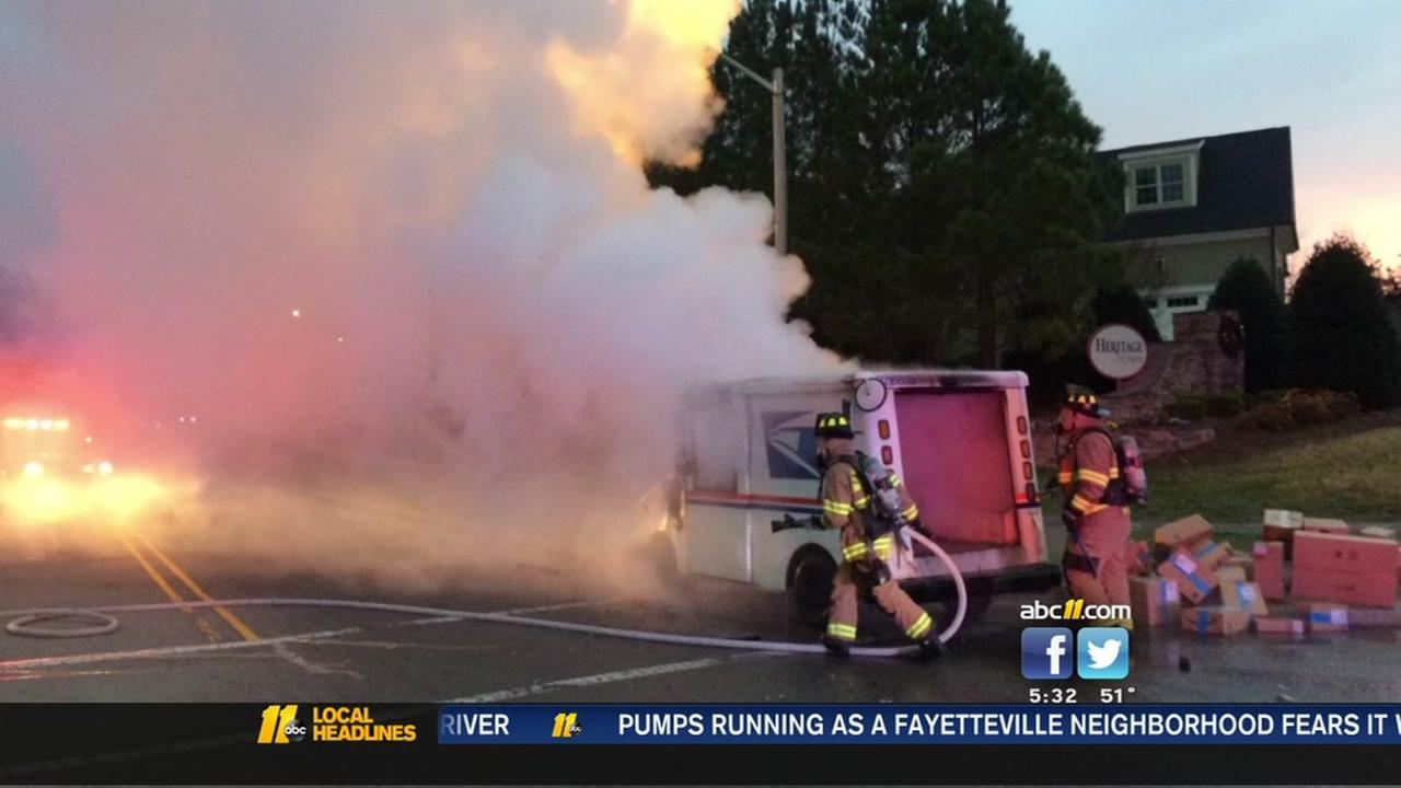 Heroic effort to save packages after mail truck catches fire