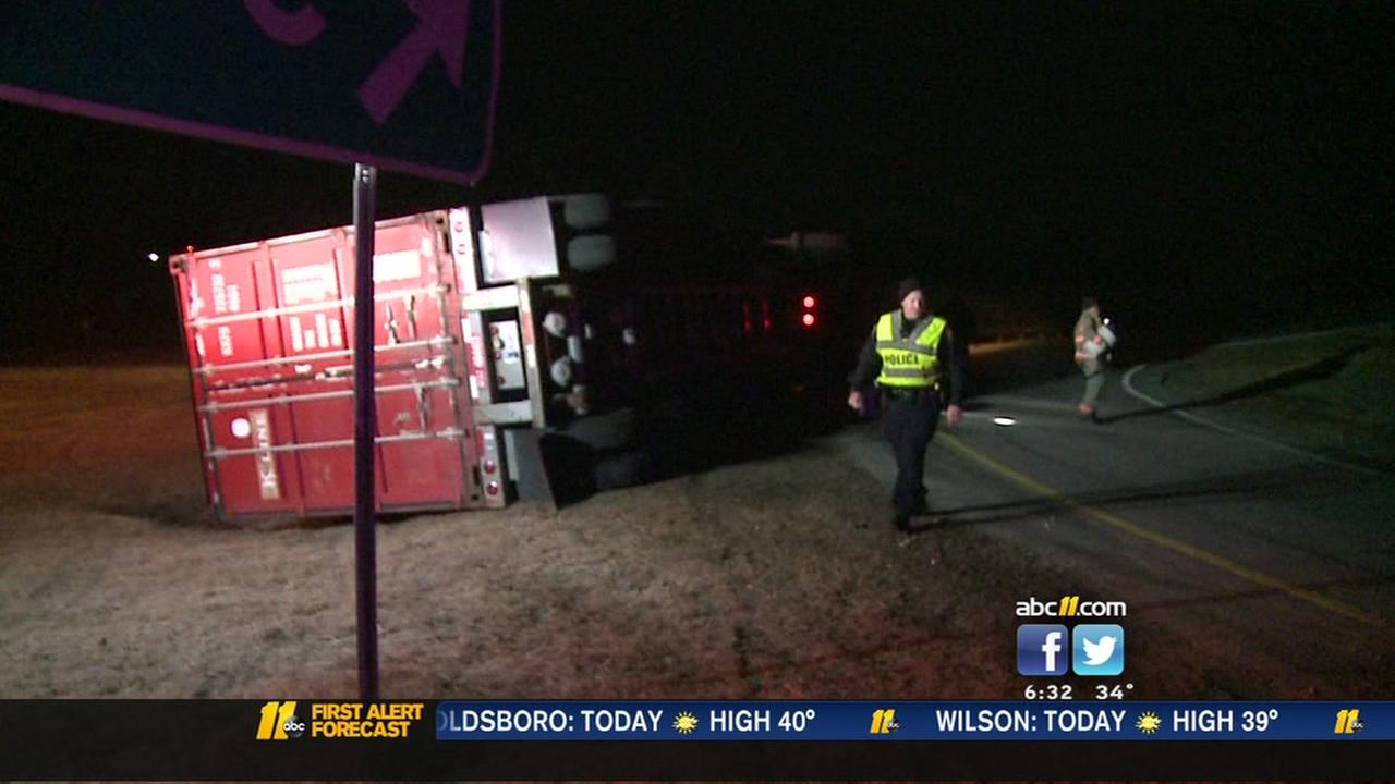 Truck overturns on ramp from 15-501