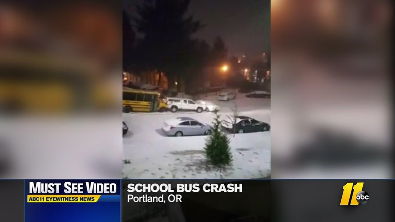School bus slides into cars