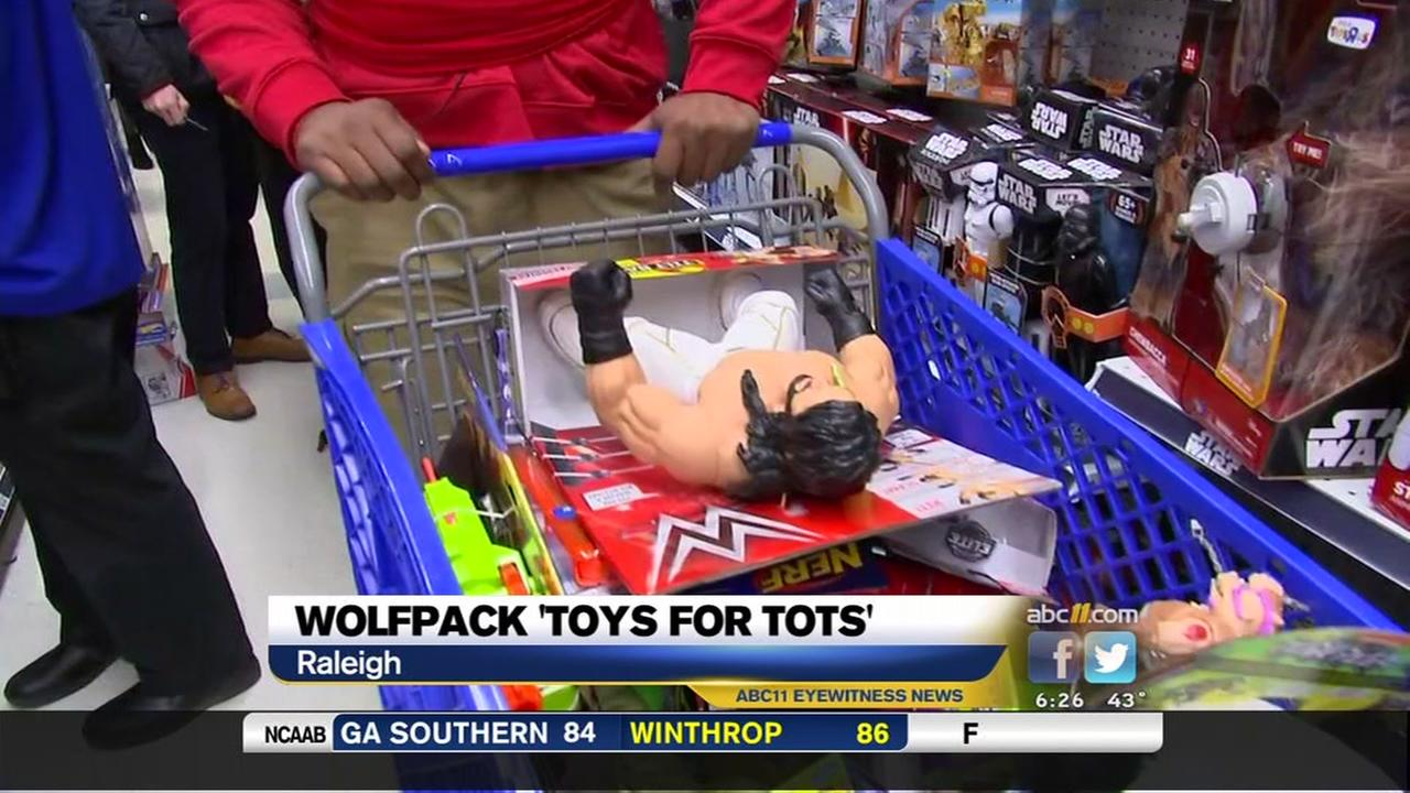 NC State football players shop for Toys for Tots