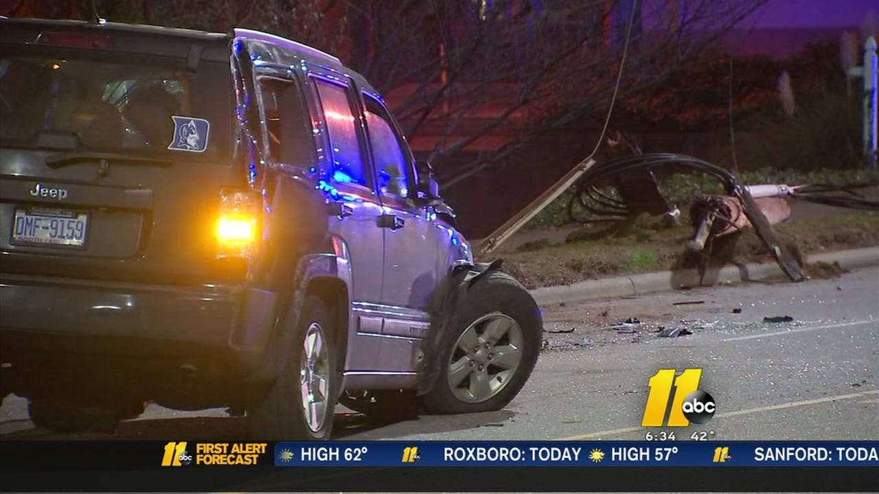 SUV crash snaps Raleigh power pole