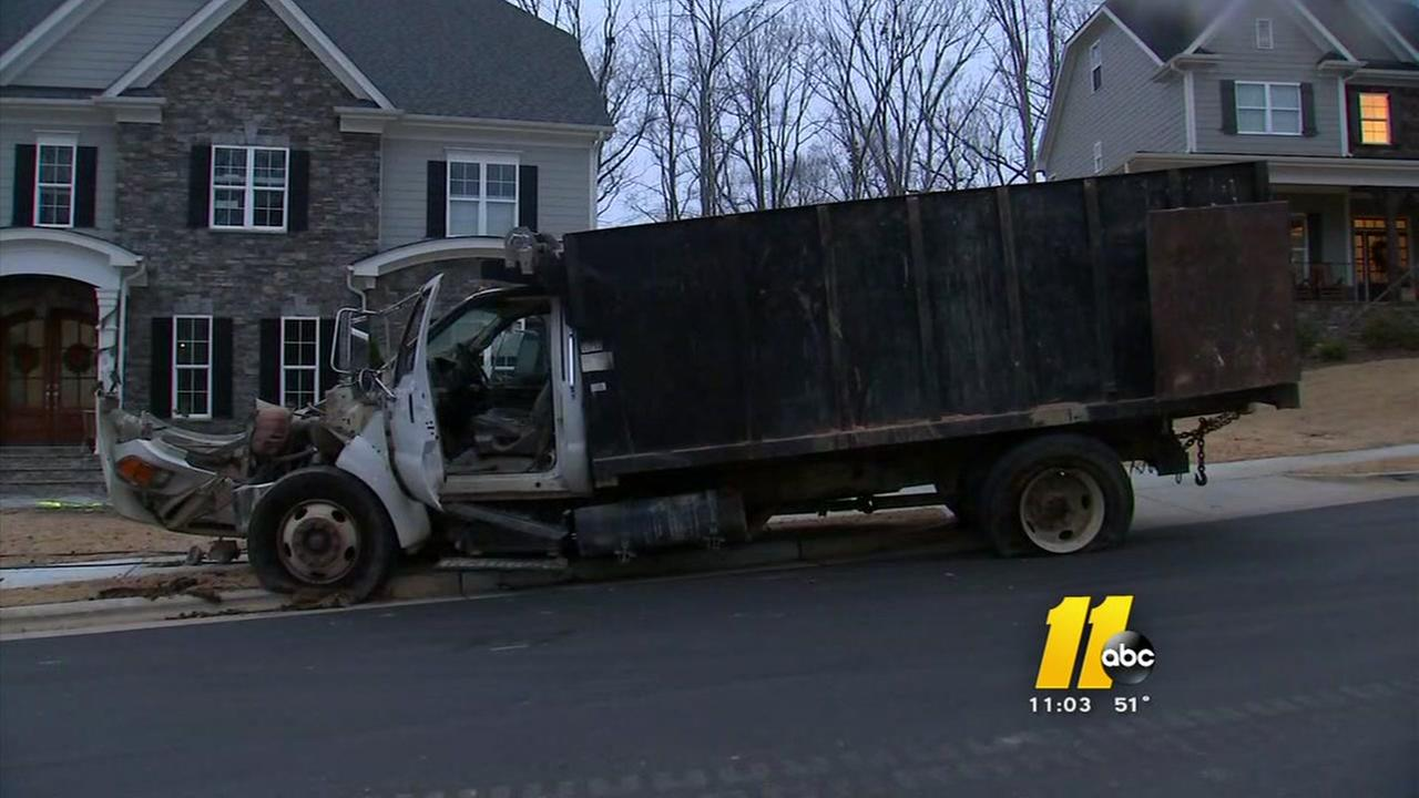 Runaway truck hits house, kills boy