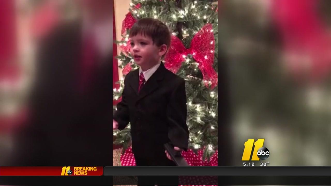 Boy gets Weather Man suit for Christmas