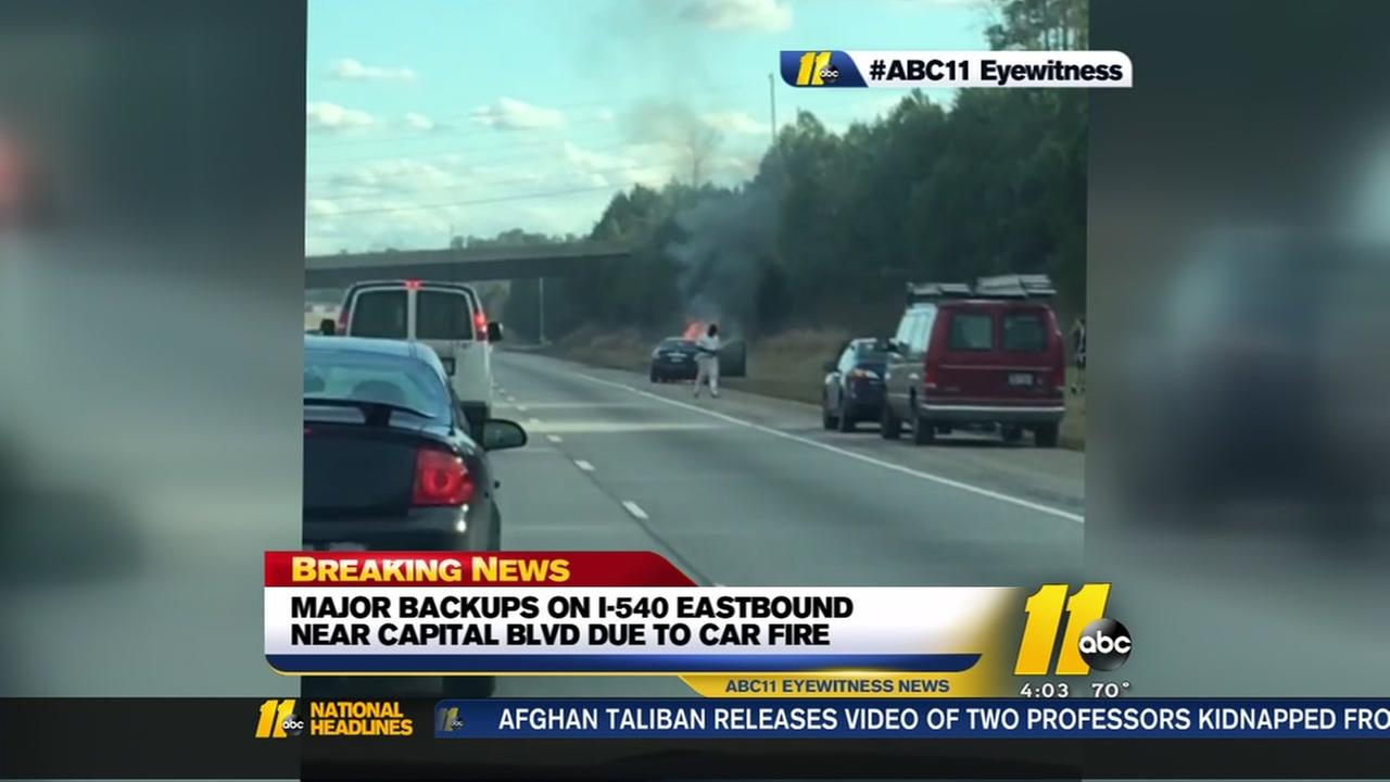 Car fire causes backups on I-540