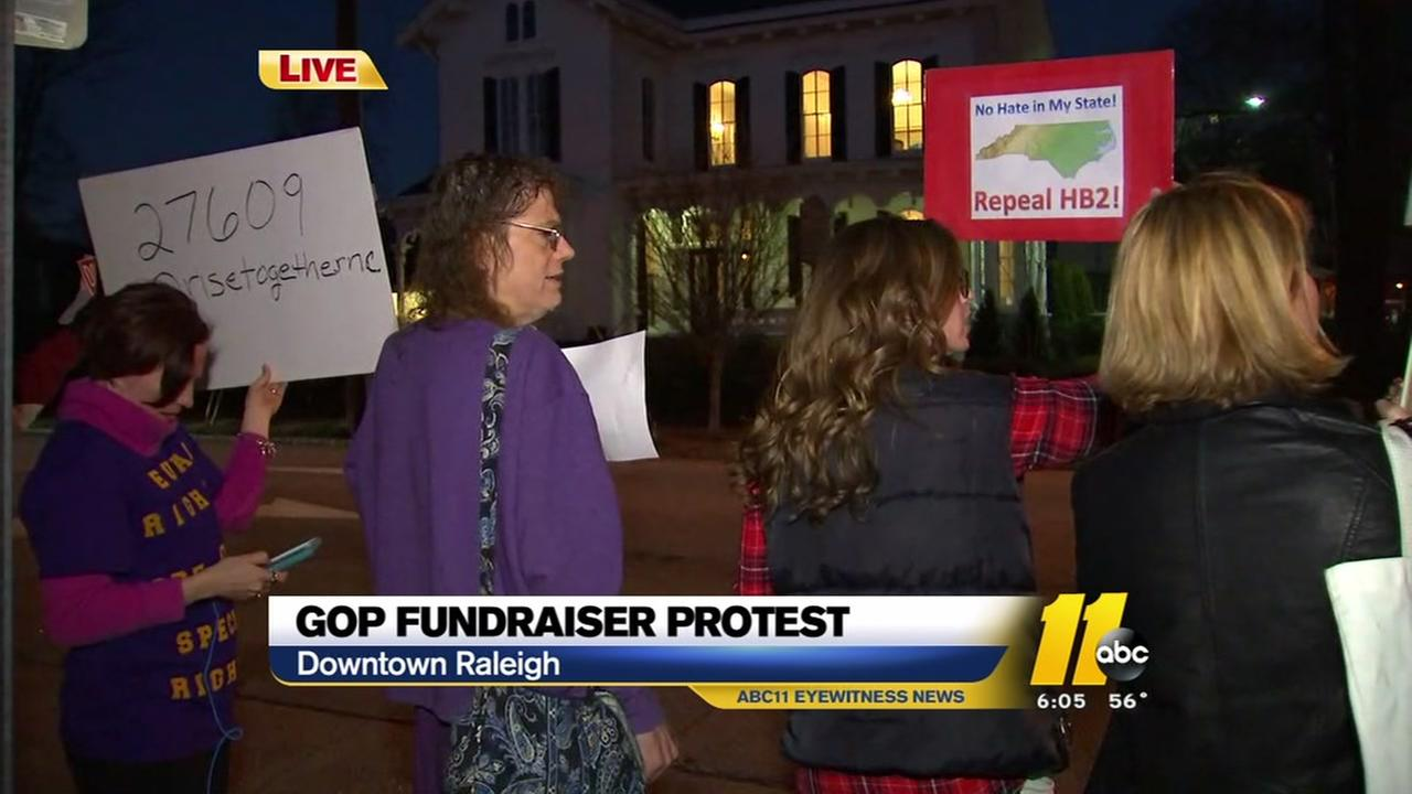 Protesters mark GOP fundraiser, new legislative session