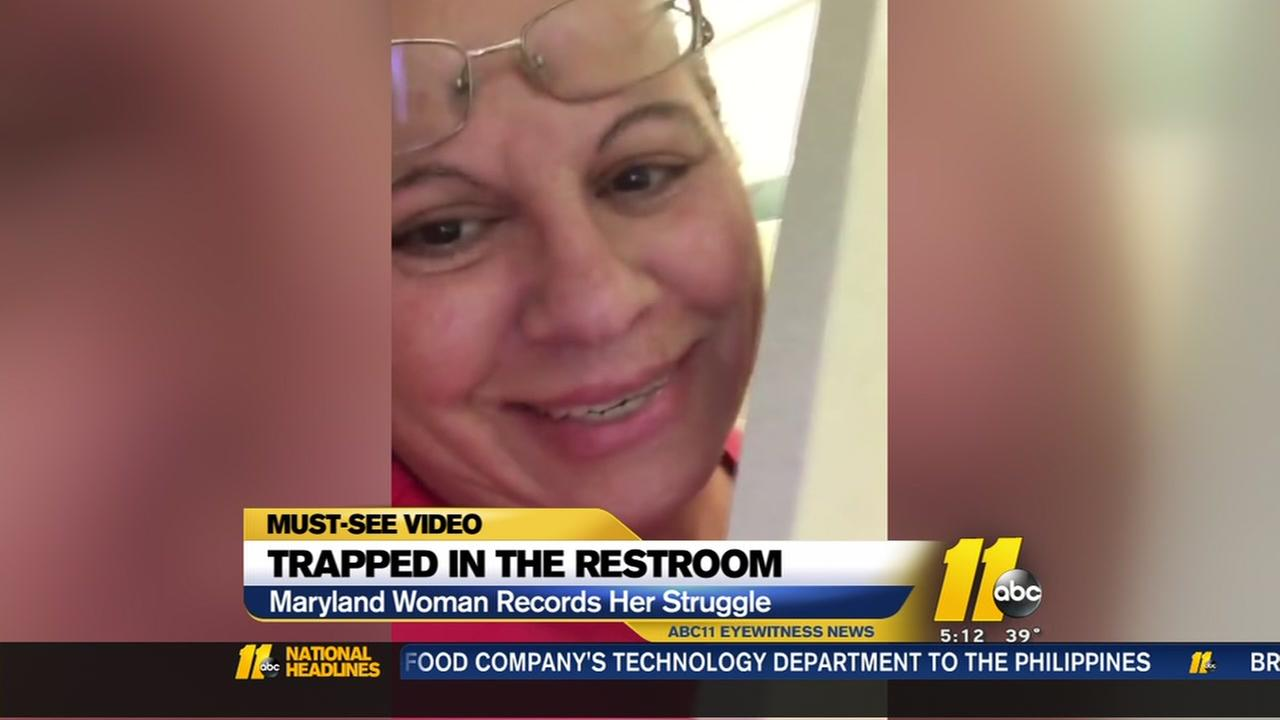 Woman records struggle after getting trapped in restroom