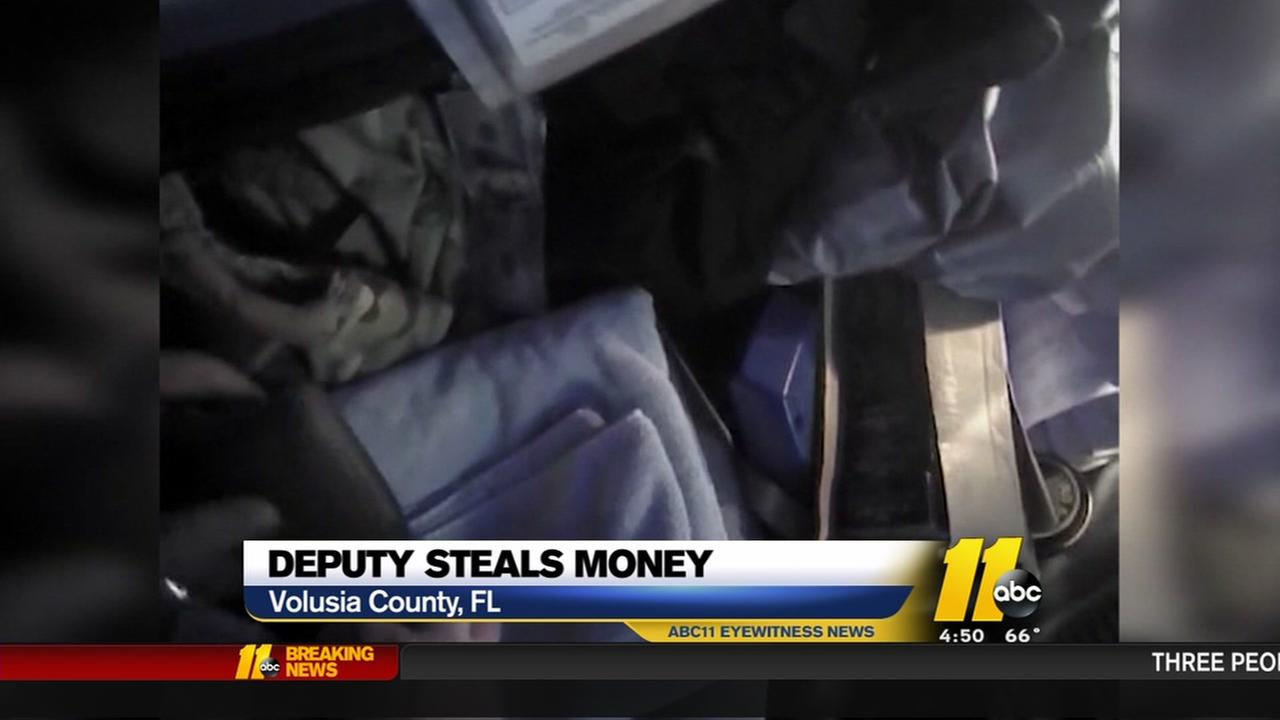 A Florida deputy out after allegedly stealing money from suspects.
