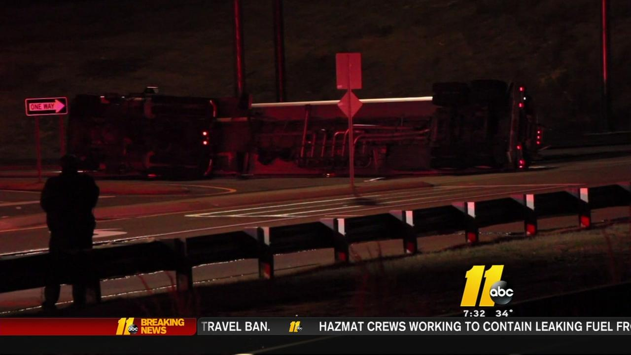 Fuel leaking from overturned tanker truck
