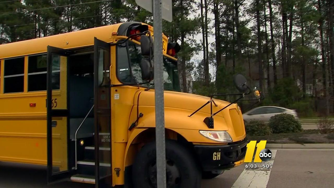 School bus driver steps down after brush with train