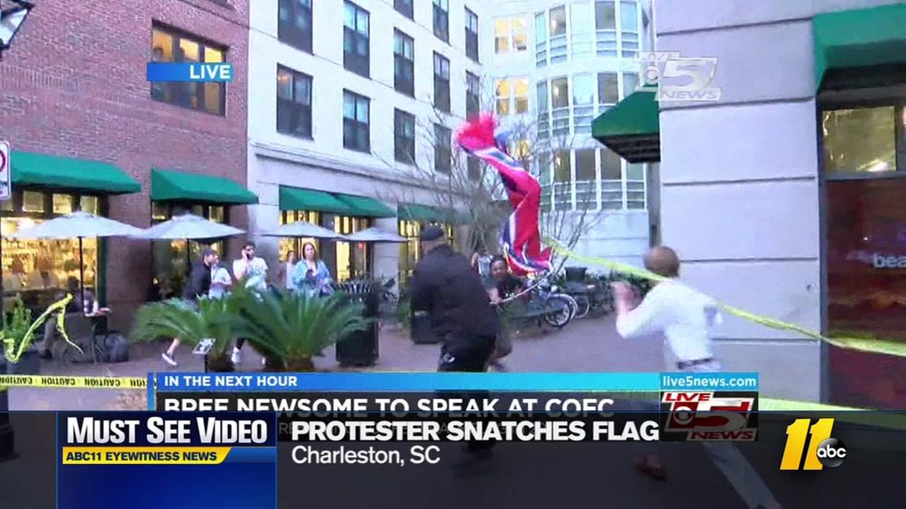 Protester tries to snatch Confederate flag on live TV