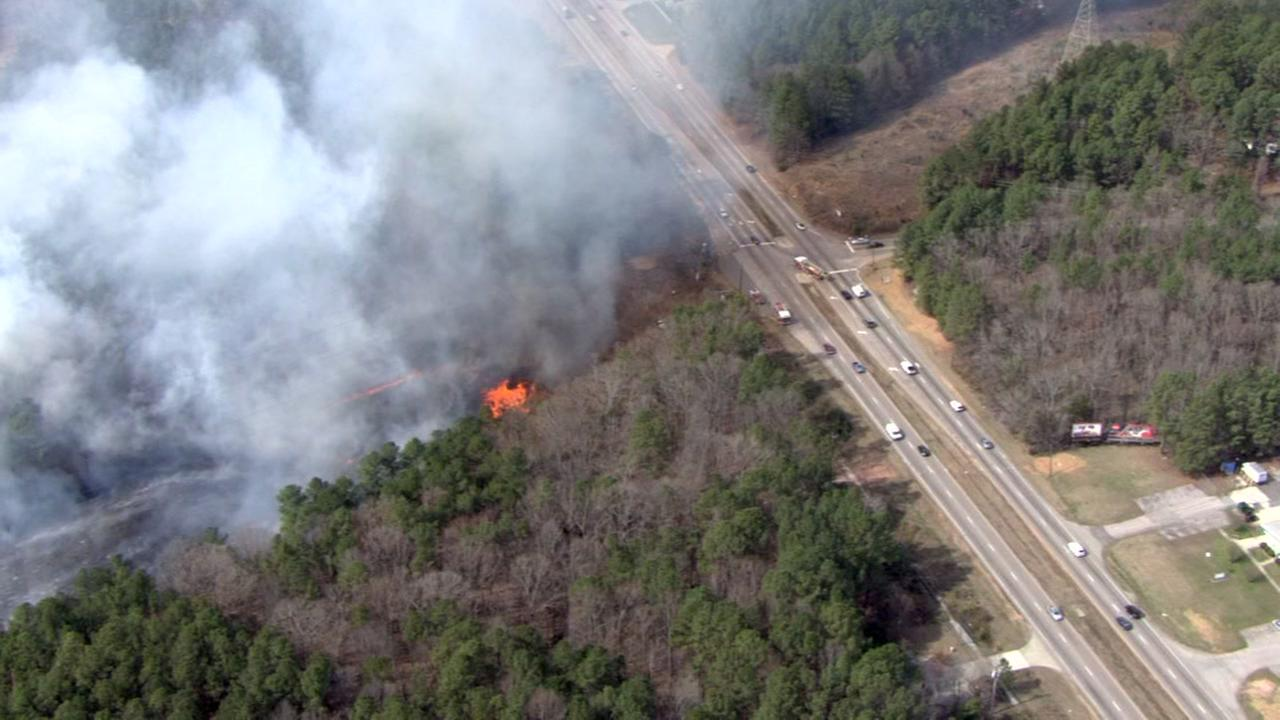 Large woods fire burns in the southeast Durham area