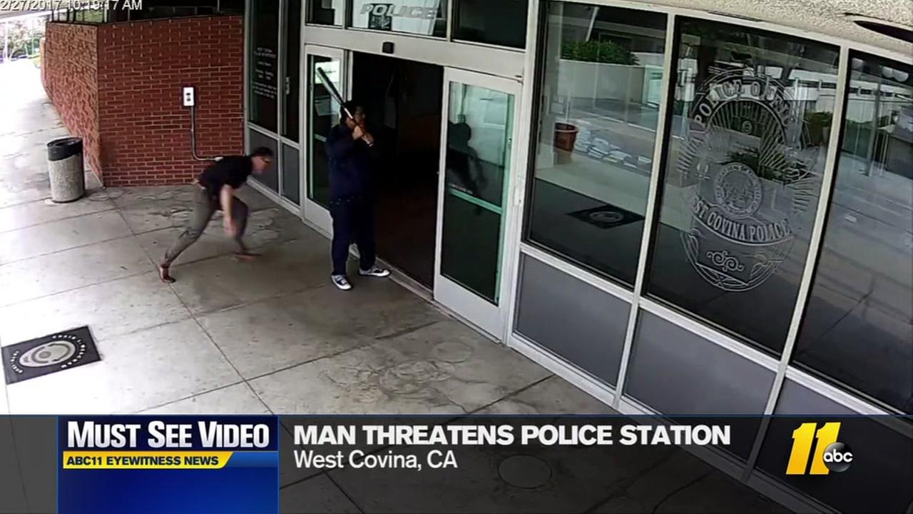 Officer tackles man with baseball bat