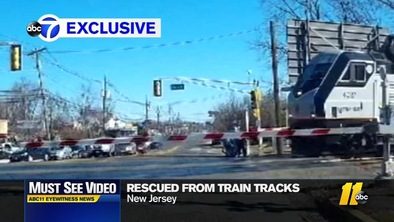 Daring rescue of elderly woman from train tracks
