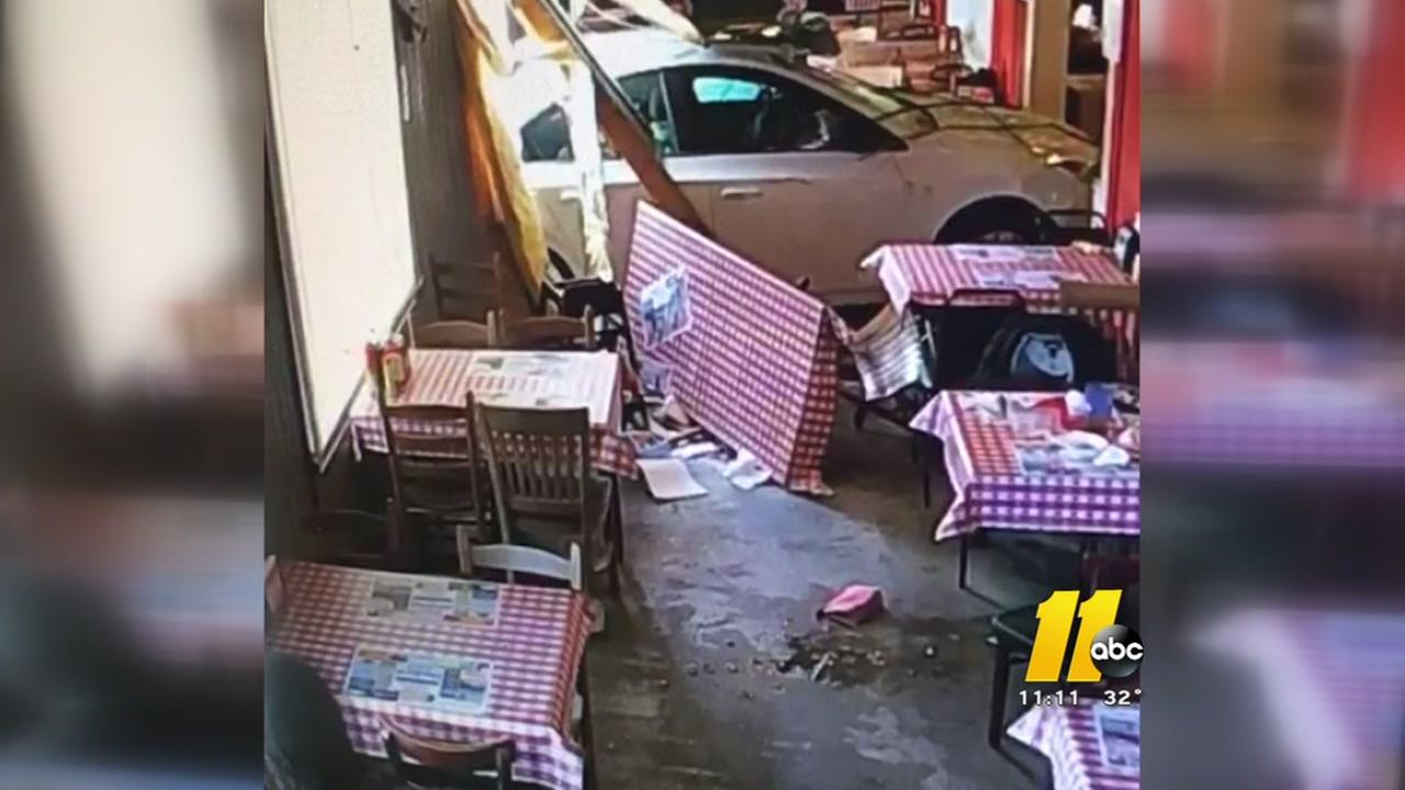 Car crashes through restaurant