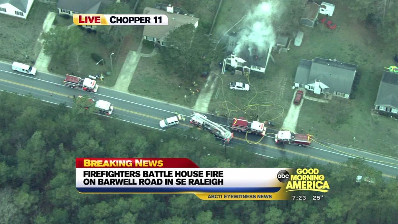 Firefighters battle house fire in Raleigh