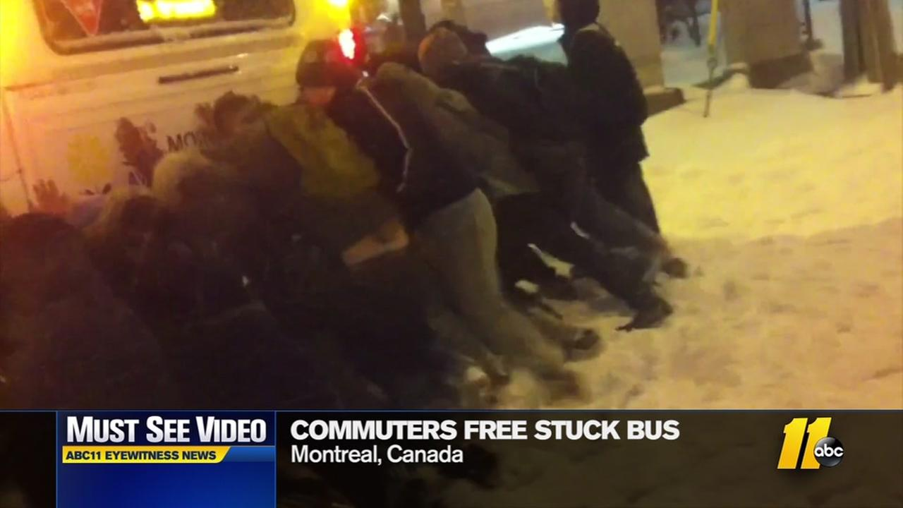 Commuters free stuck bus