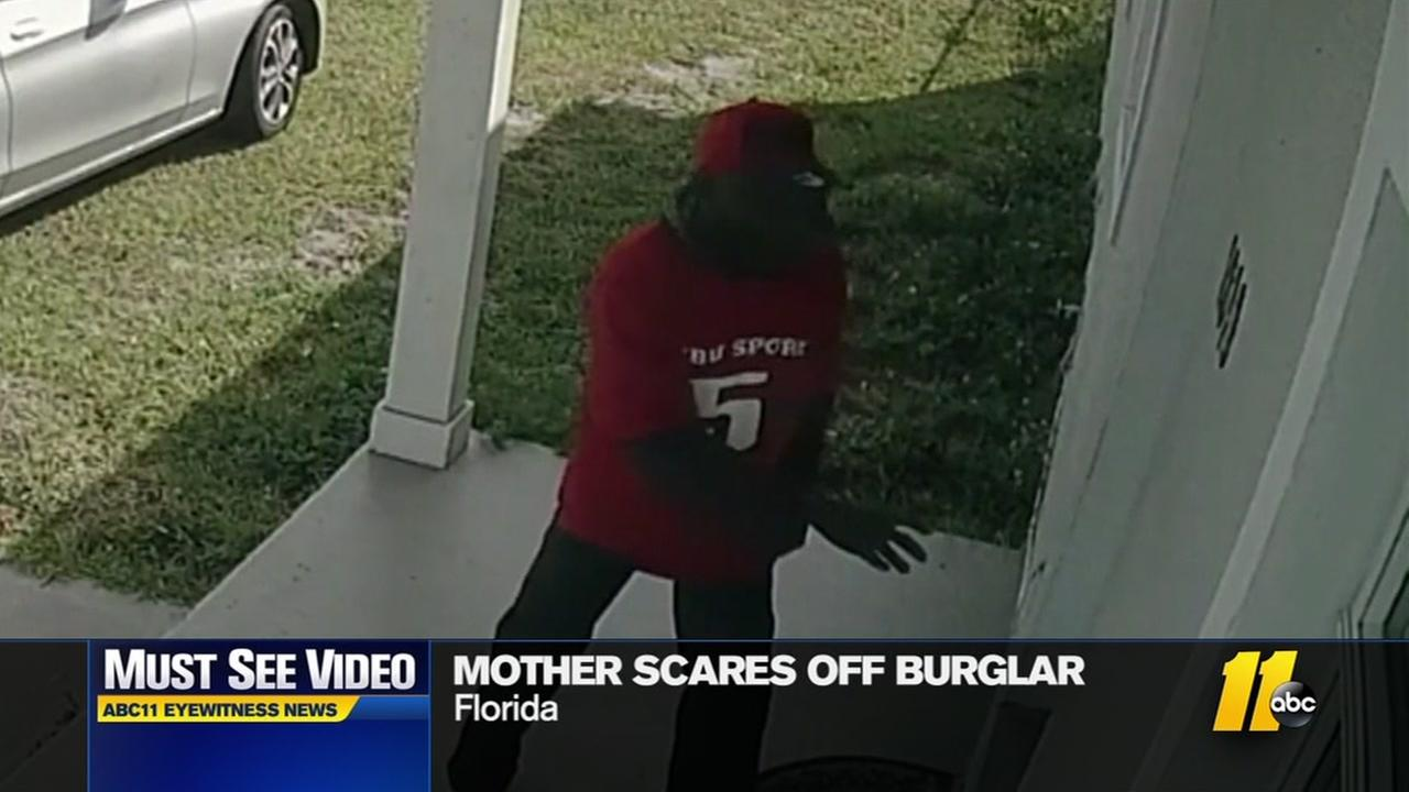 Mother scares off burglar
