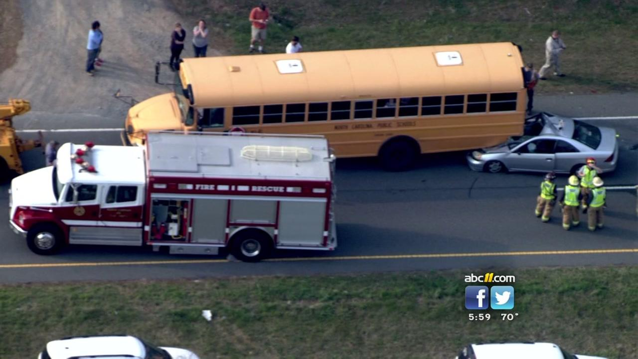 Car slams into school bus near Pittsboro