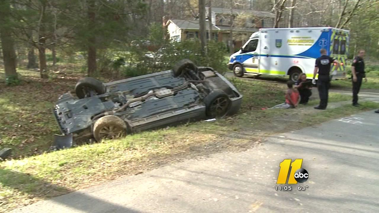 Car flips after chase in Durham