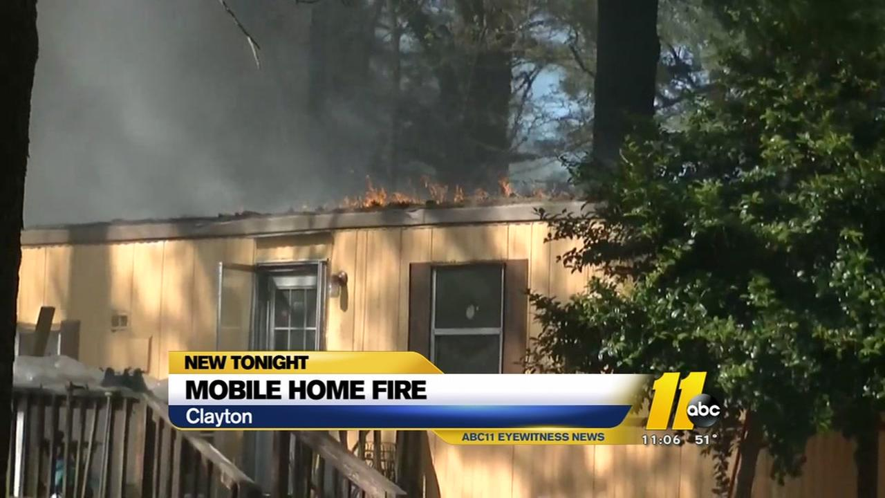 Firefighters battle Clayton mobile home fire
