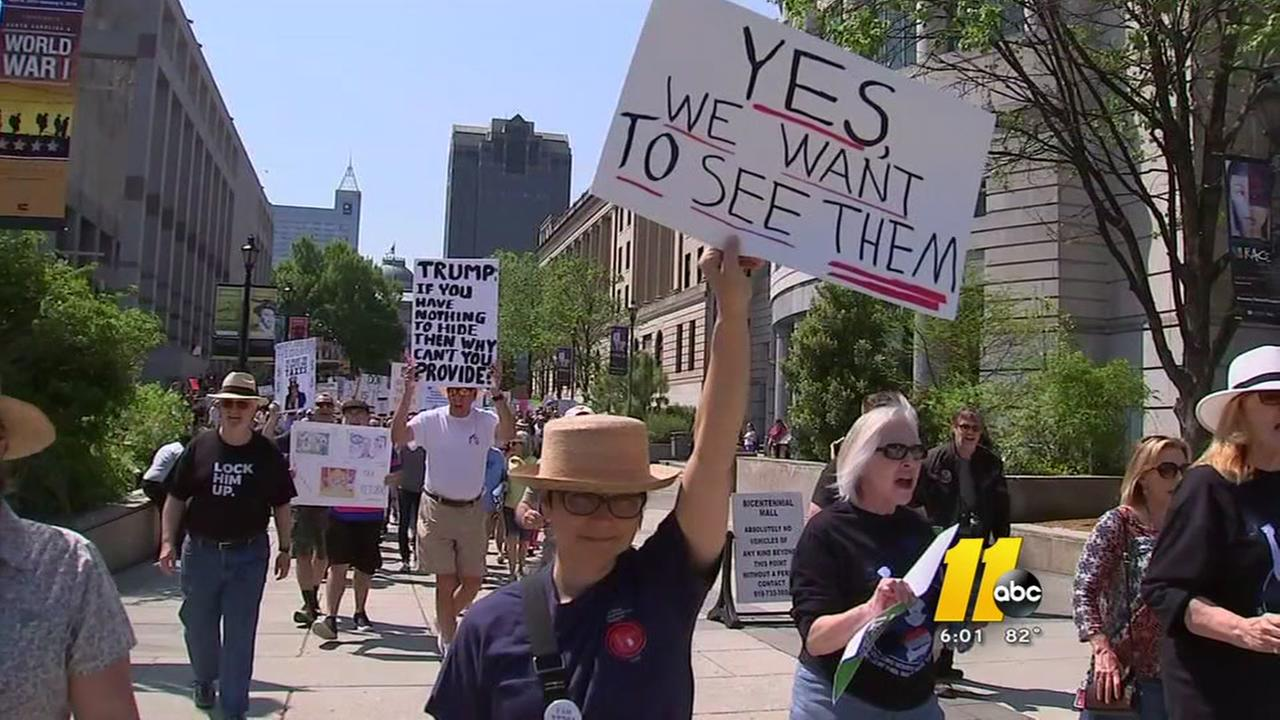 Protesters march to deman Trump release tax returns