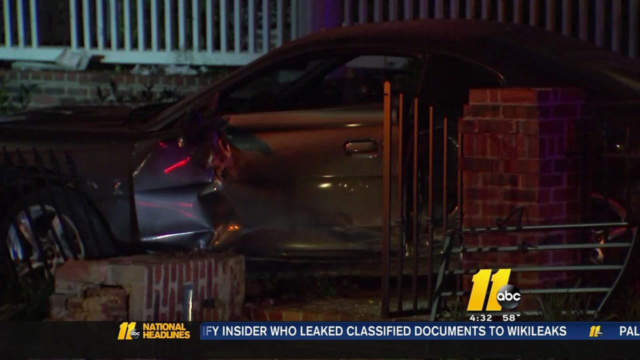 Driver slams through fence, ends up in front yard of Raleigh home