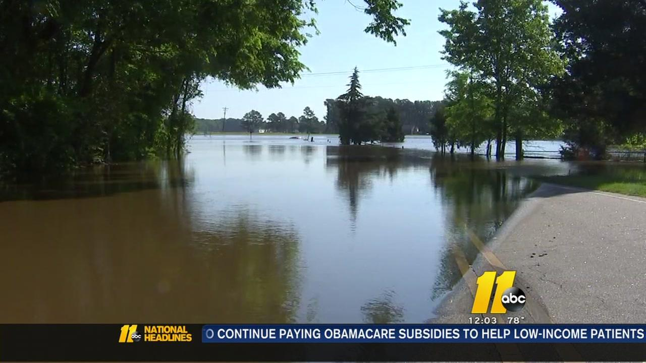 Woman drowns after driving through floodwaters