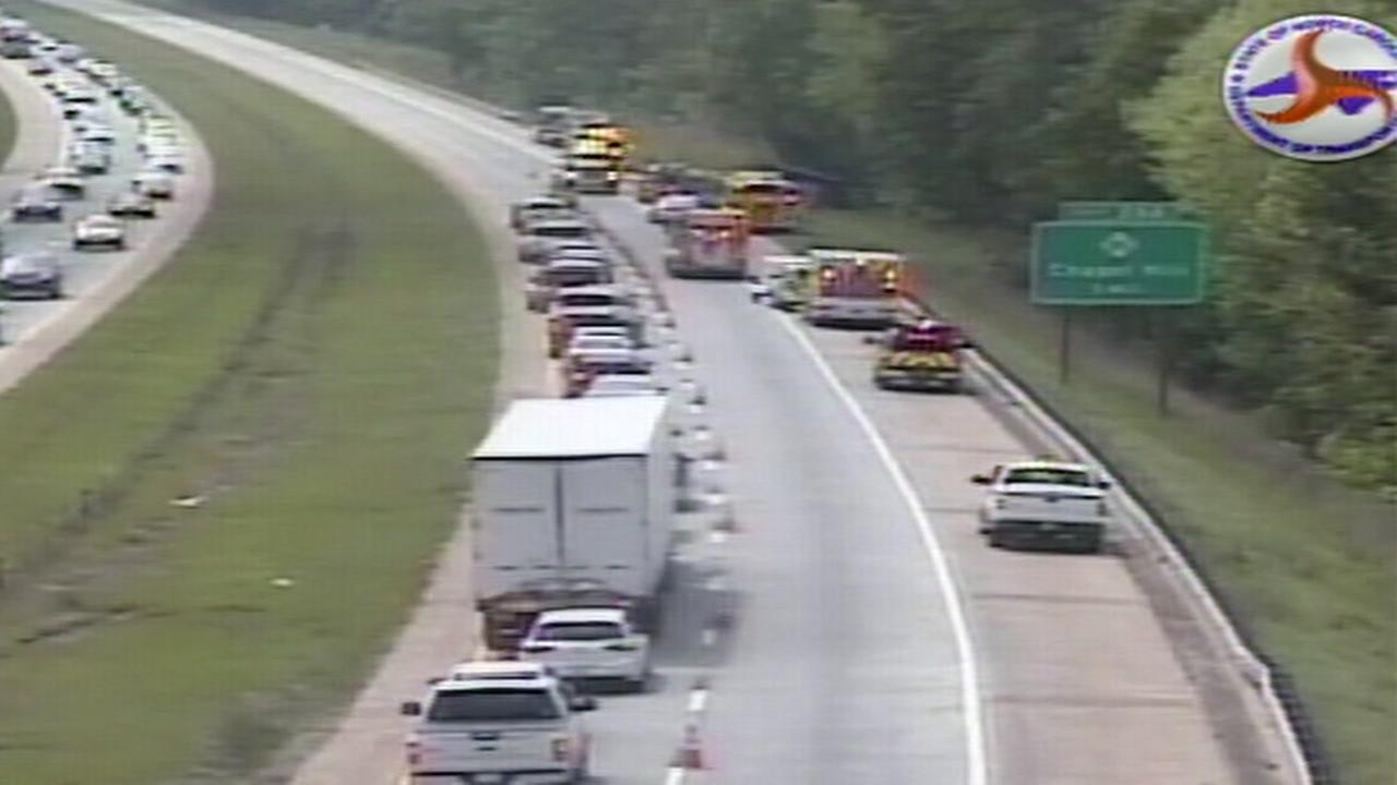 Overturned tractor-trailer closes lanes on I-40 east in Orange County