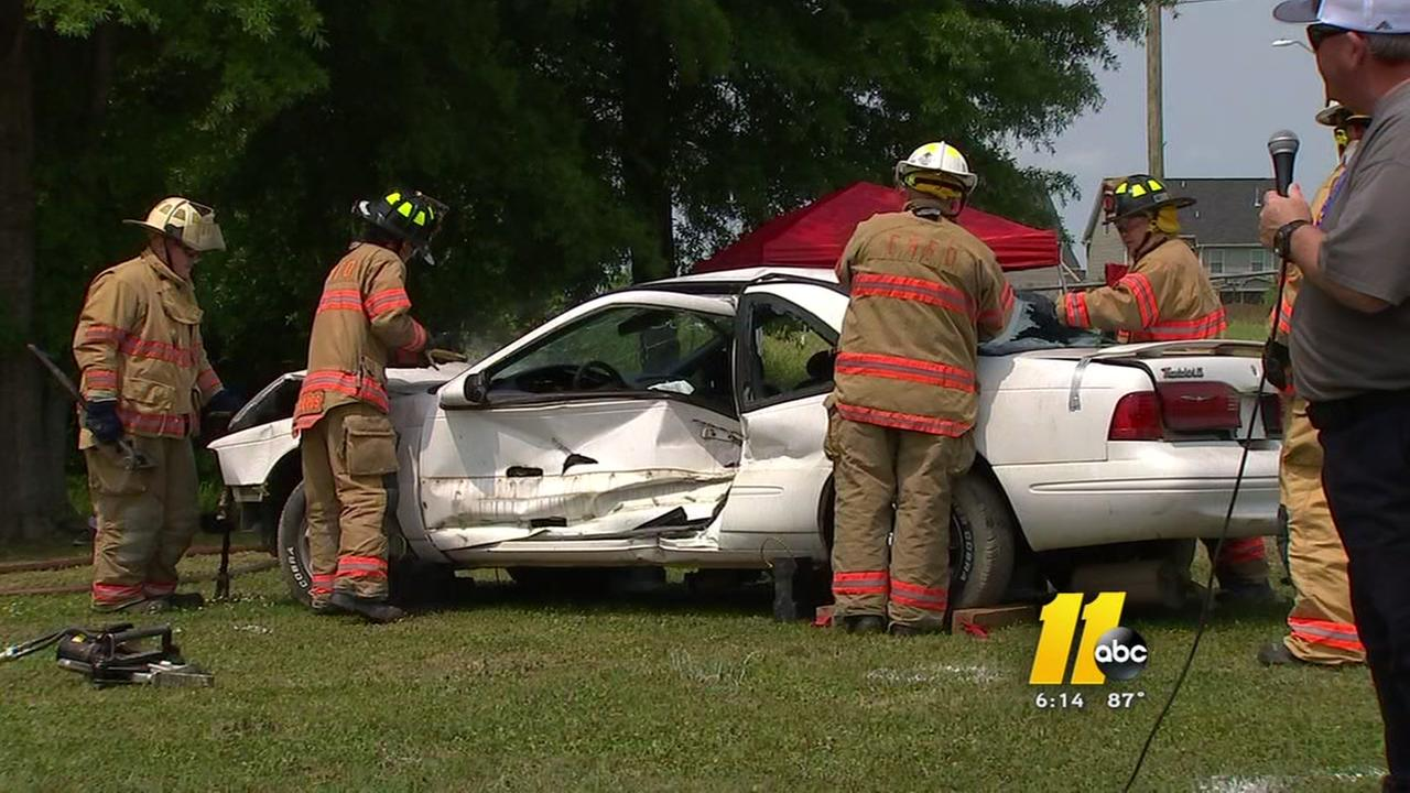 Teens watch safe driving demonstration
