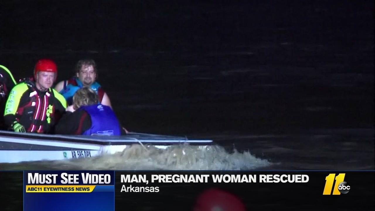 Man and pregnant woman rescued from flood