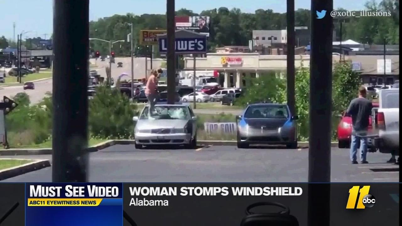 Woman stomps on car windshield