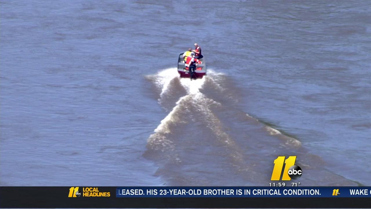 Mother and son rescued from river