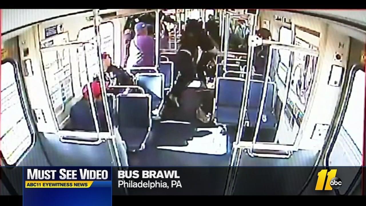 Bus brawl involving gun caught on video