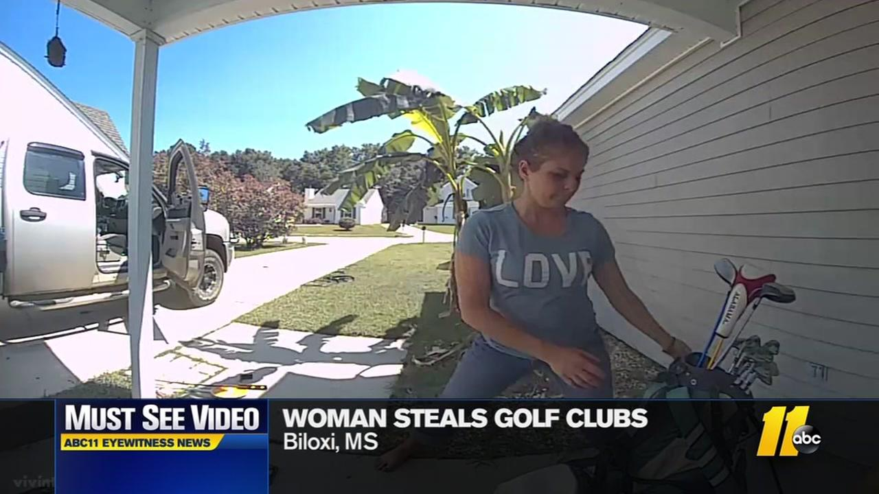 Woman shown on camera stealing golf clubs