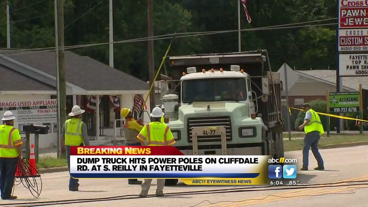 Fayetteville street closed after dump truck hits power pole