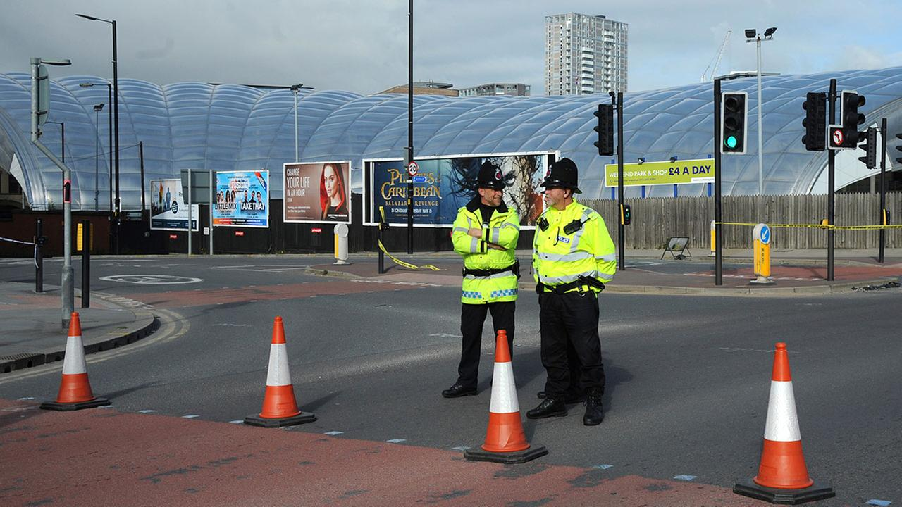 Police block a road outside the Manchester Arena in central Manchester, England Tuesday