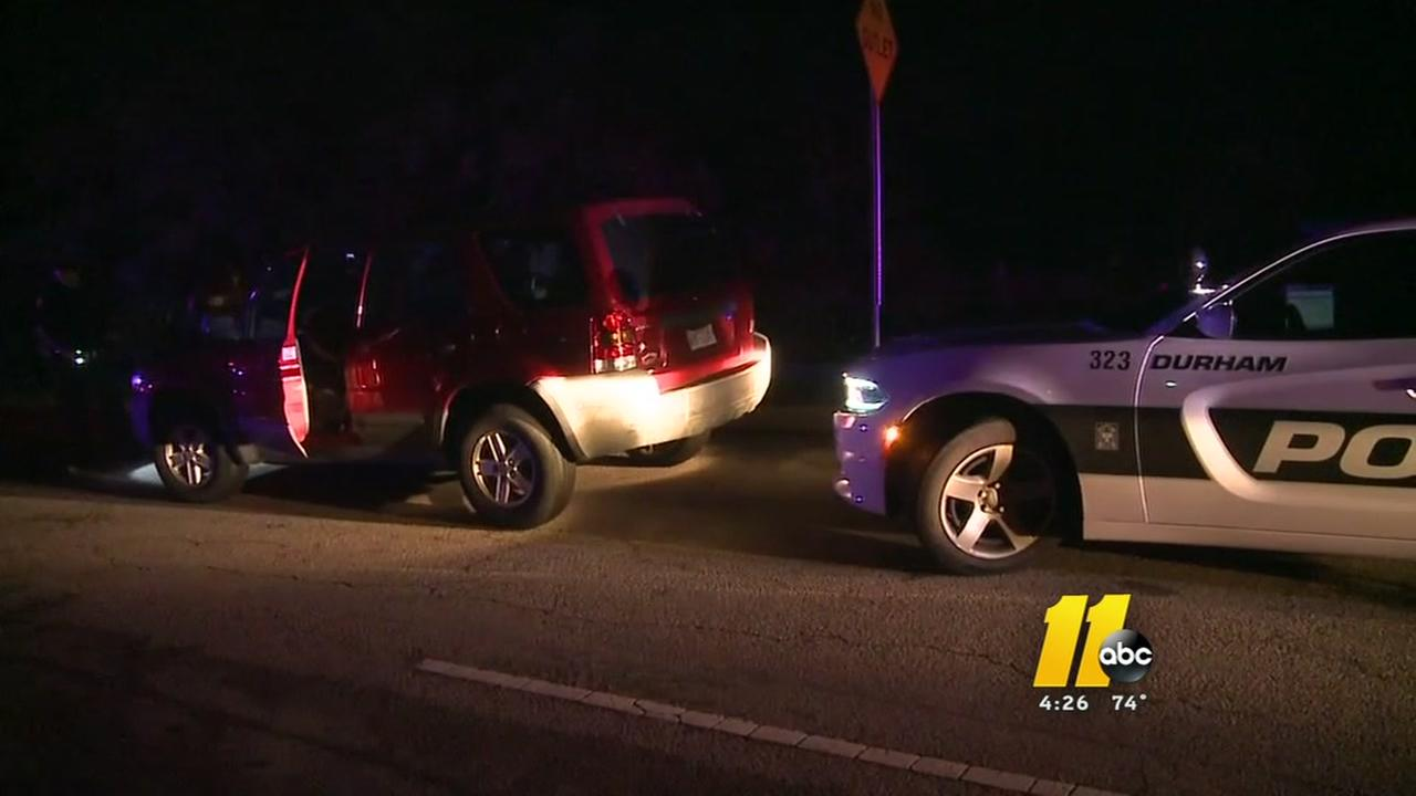 Durham police catch woman riding on SUV hood on I-40