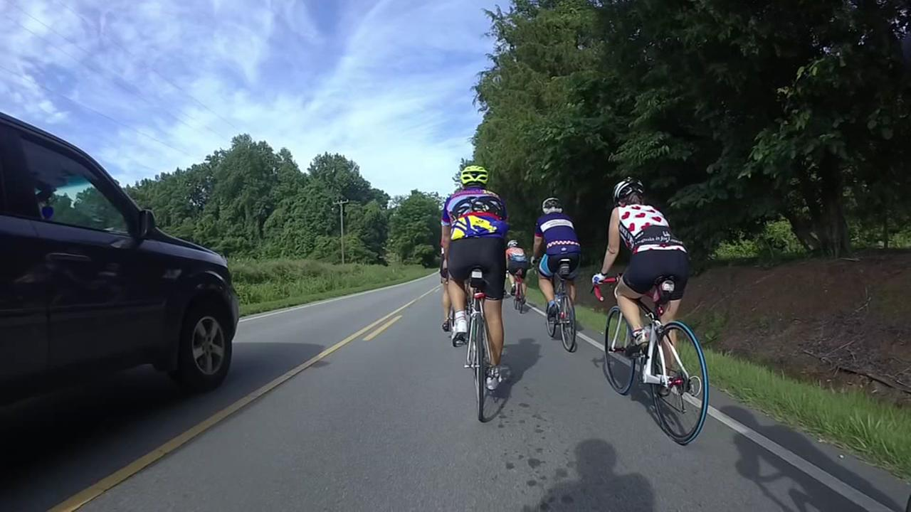 Raw video: Cyclists, vehicle have close call
