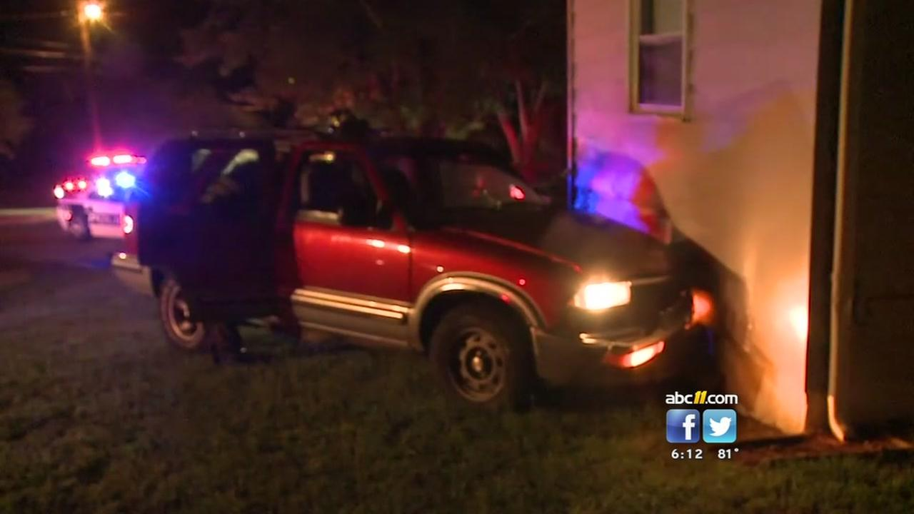 Two brothers received a big scare after an SUV plowed into their home after crashing into a police car.