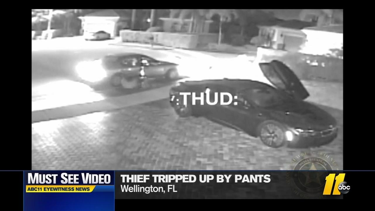 Watch: Thief tripped up by pants