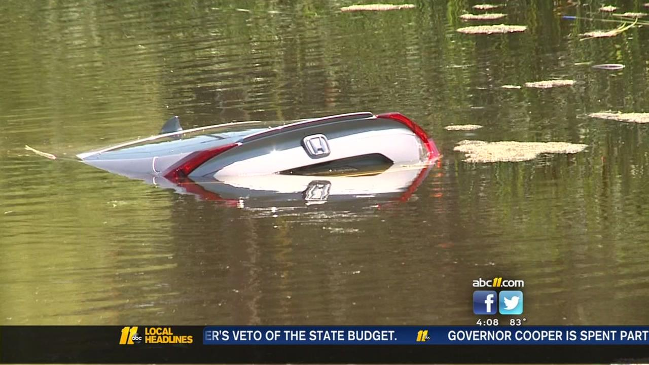 Driver, pregnant passenger rescued from partially submerged car in Durham