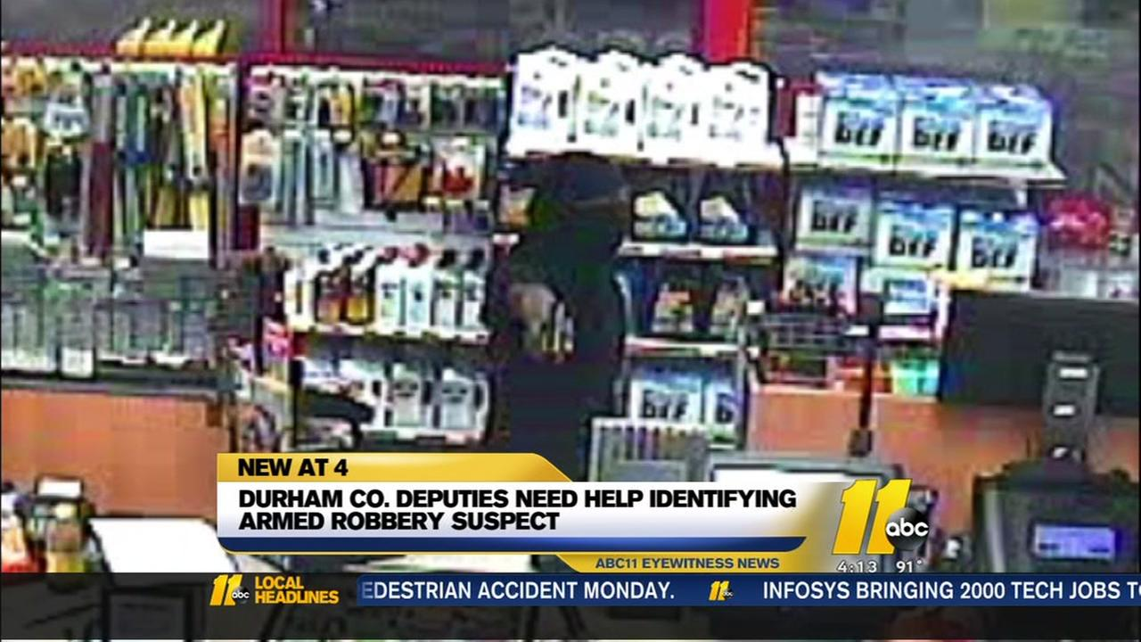 Surveillance photos of armed robbery suspect released