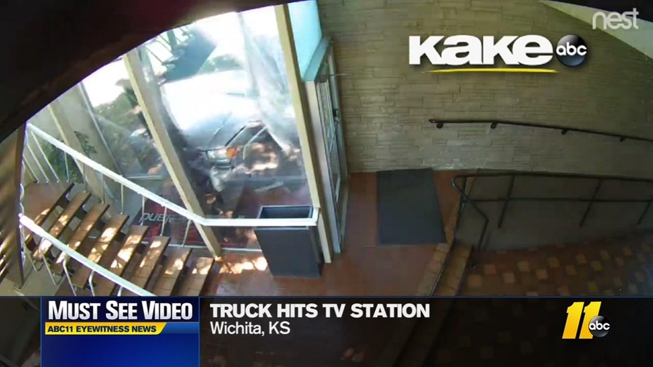 Watch: Truck hits TV station