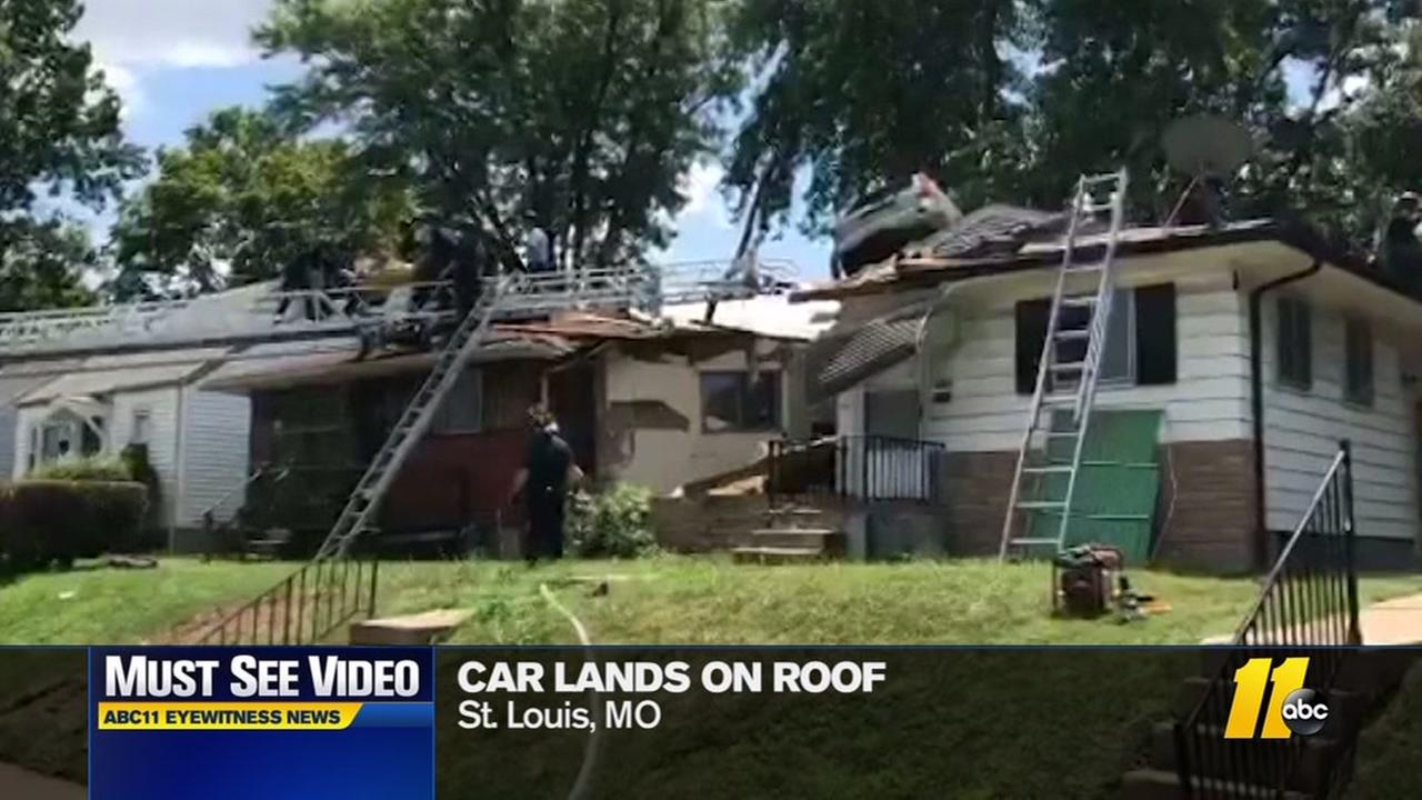 Must-see video: Car lands on homes roof