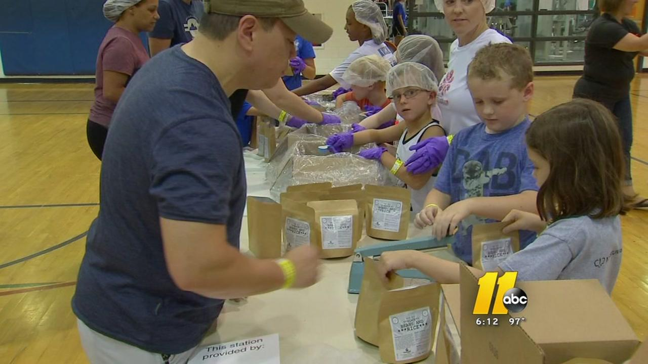 Volunteers in Wake County assemble 10,000 meals for hungry kids