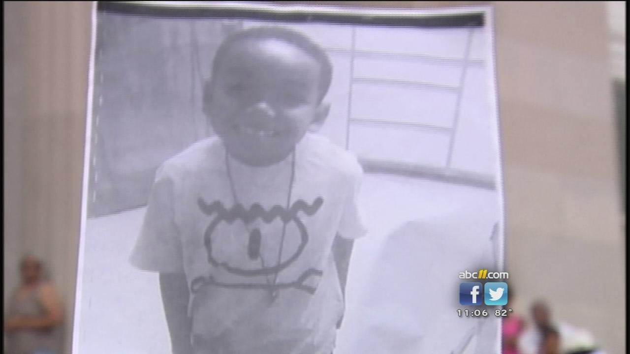 Vigil honors 7-year-old hit by bullets while he was sleeping